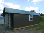 Colored storage buildings with colored metal or vinyl siding.